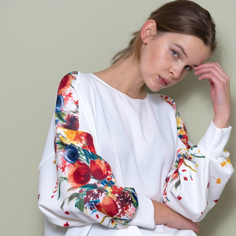 White Oversized Top With Bright Floral Sleeves by Minkie London on OOSTOR.com
