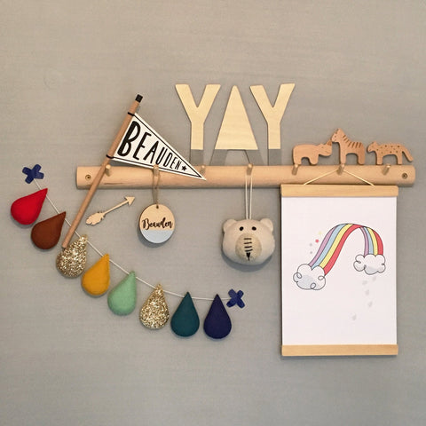 Personalised Wooden Name Plaque hanging on the wall amongst other kids decor pieces