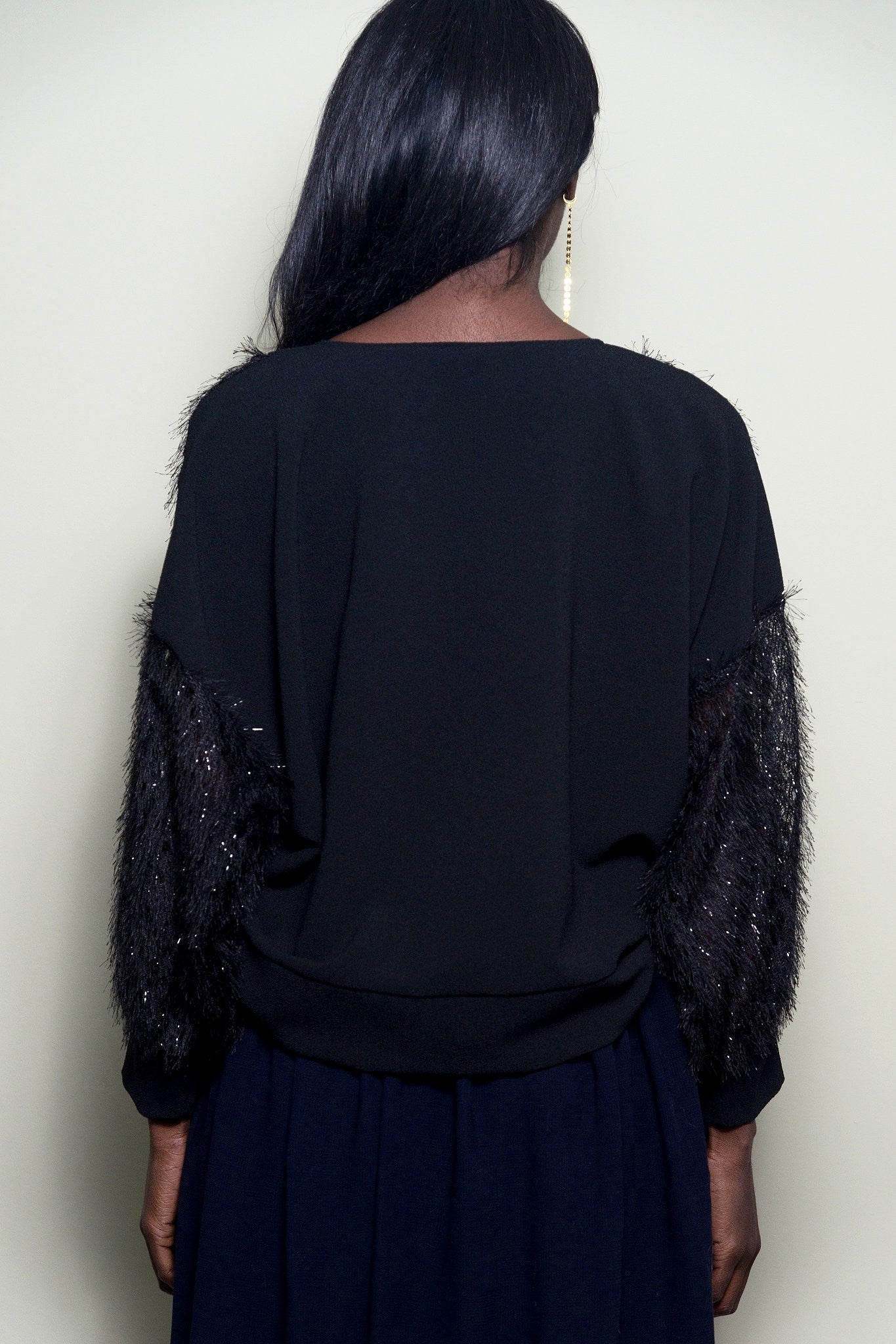 Black Oversized Top With Fringe Sleeves by Minkie London on OOSTOR.com