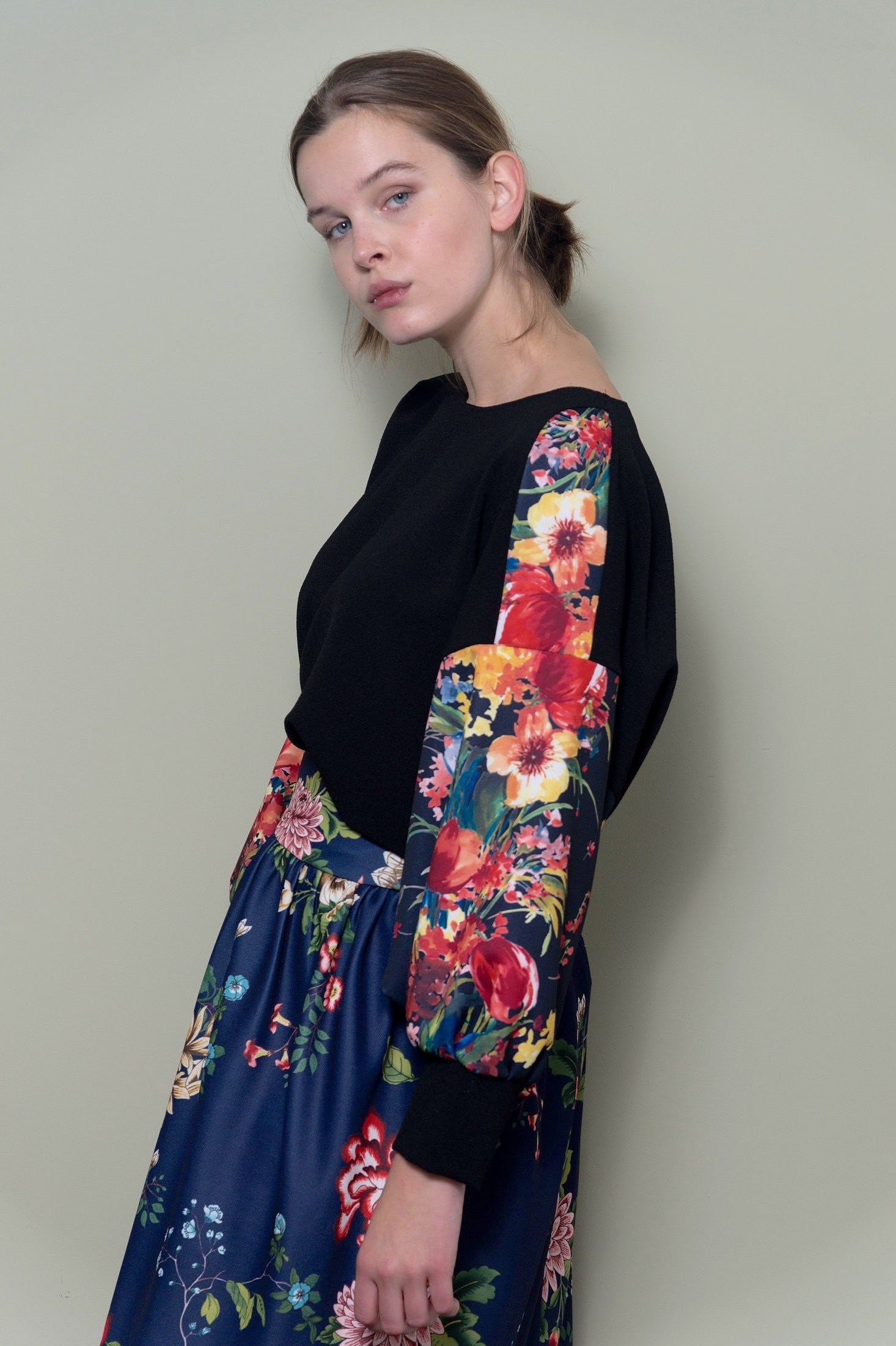 Black Oversized Top With Bright Floral Sleeves by Minkie London on OOSTOR.com