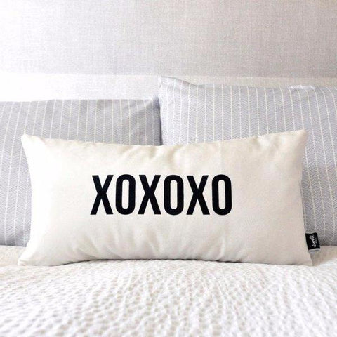 XOXOXO Throw Pillow by Swell Made Co on OOSTOR.com
