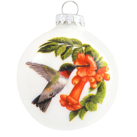 Hummingbird with flowers on front and the symbolism on the backside. Glass Ornament