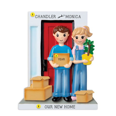 New Home Couple with boxes outside front door resin ornament  Edit alt text