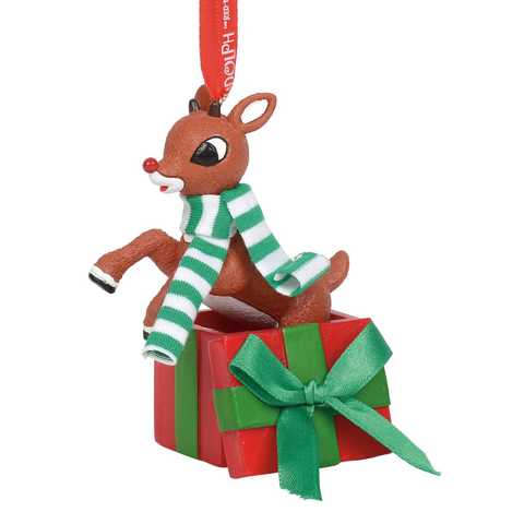 Rudolph leaping out of a Christmas present ornament