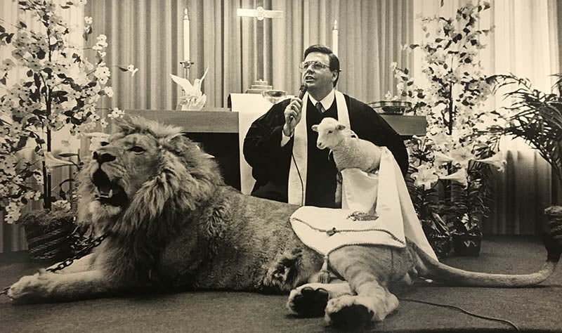 Dr. Jim Lavender with a lion & a lamb