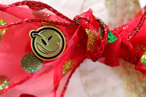 YUMS gold pin ribbon christmas present