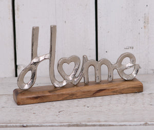 Metal Home Ornament on Wooden Stand