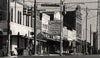 Old Vintage Signs, Main Street, Llano Texas, Black & White Photograph - Black and White Photography by Andy Moine