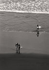 Black and White Photography, Surfers at Raglan Beach, New Zealand - Black and White Photography by Andy Moine