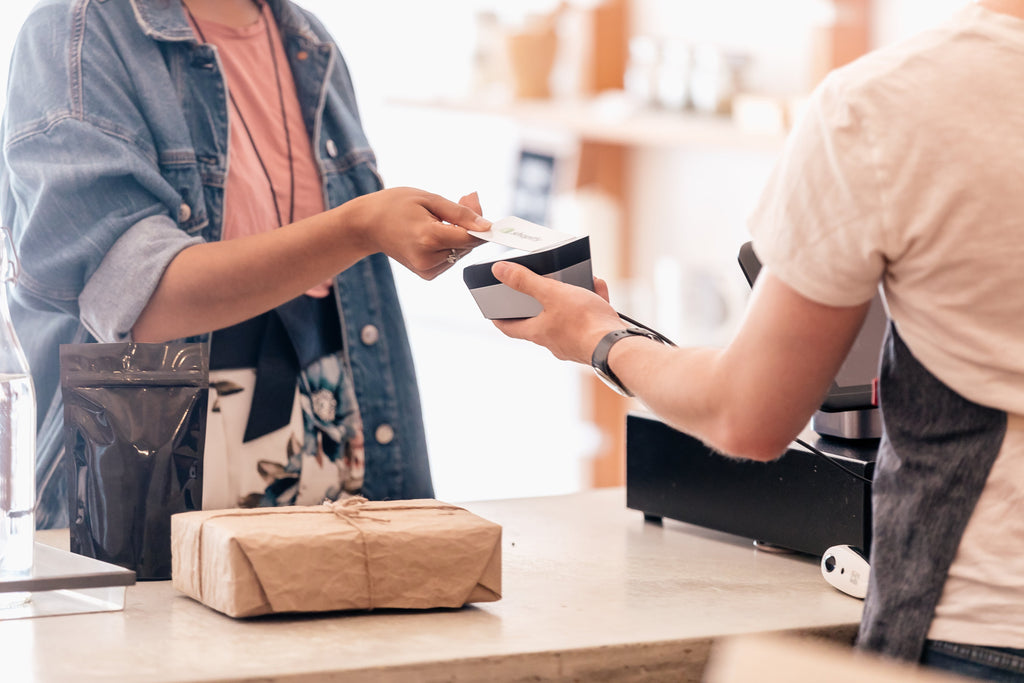 person paying in store credit card shopify pos