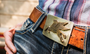 A flying Pegasus can be found emblazoned on the front of this bronze belt buckle with stainless steel back