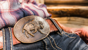 A bison wandering is the feature of this bronze belt buckle
