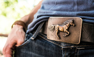 A horse in full gallop is caught on this bronze belt buckle by Elaine Hansard