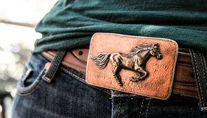 A horse running in the wind is captured on this bronze belt buckle.