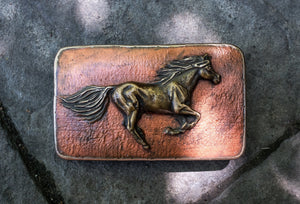 A galloping horse is caught on this magnificent bronze belt buckle
