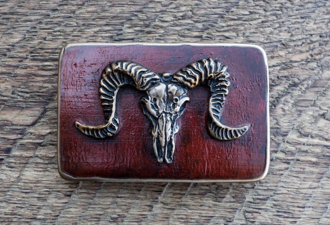 """Ram skull"" bronze belt buckle with a red patina"