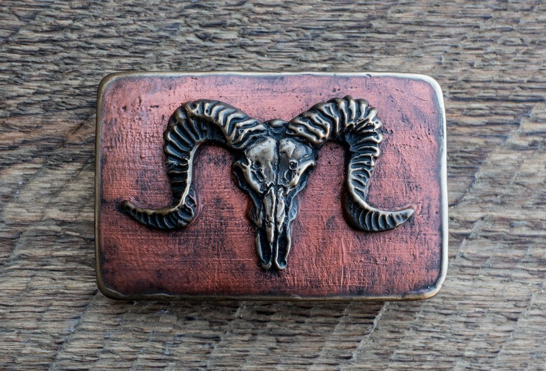 """Ram skull"" bronze belt buckle with a copper patina"