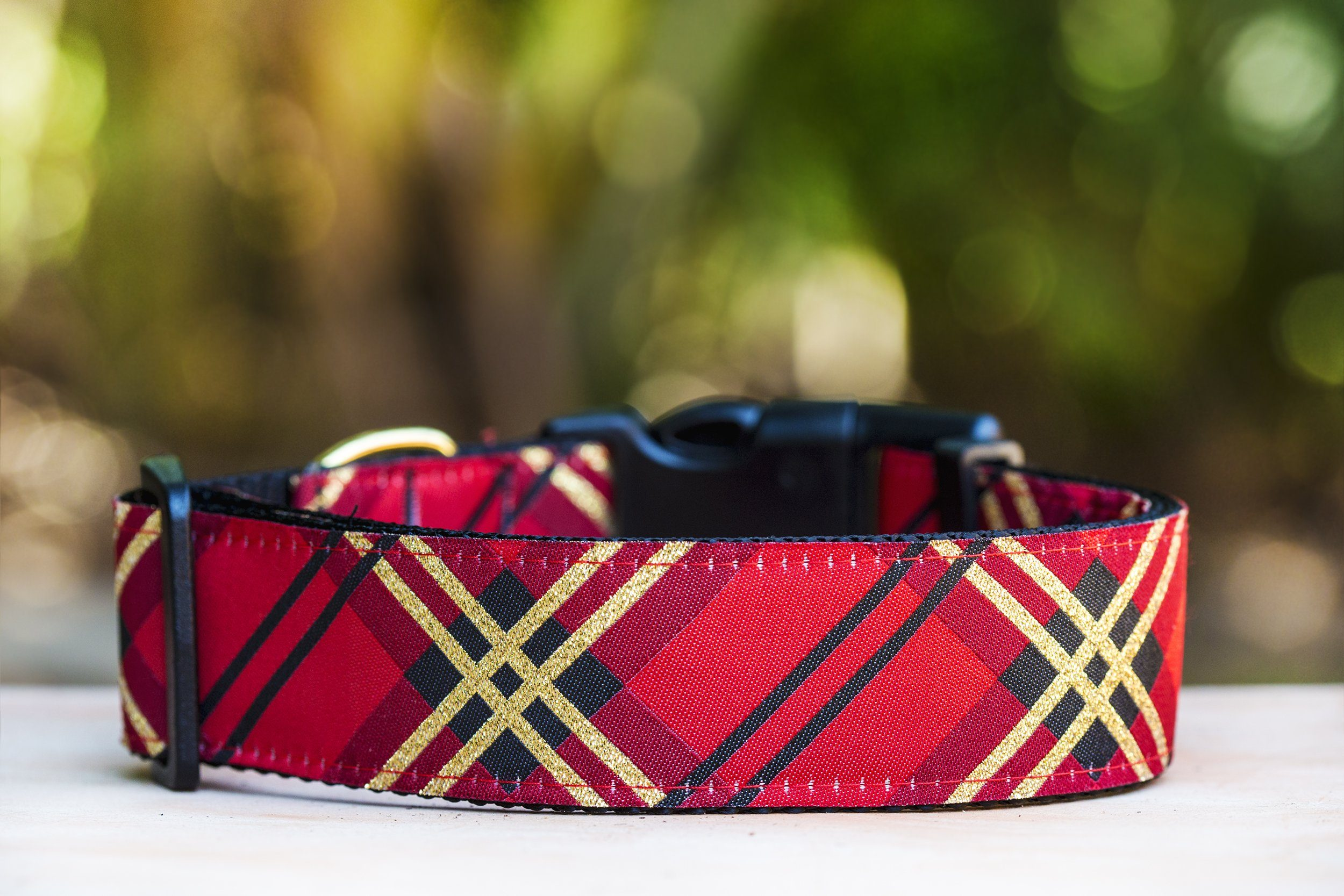 a red and gold dog collar, with woven gold glitter throughout. Handmade in Australia, this dog collar is a beautiful addition for larger dogs.