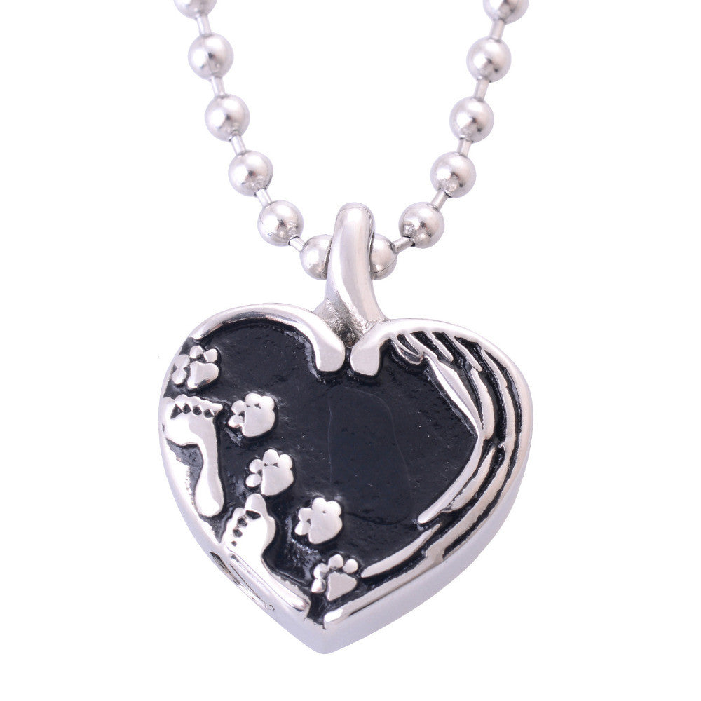 Pet Dog and Person Footprints side by side in a Heart Pendant Necklace for Cremation Ashes