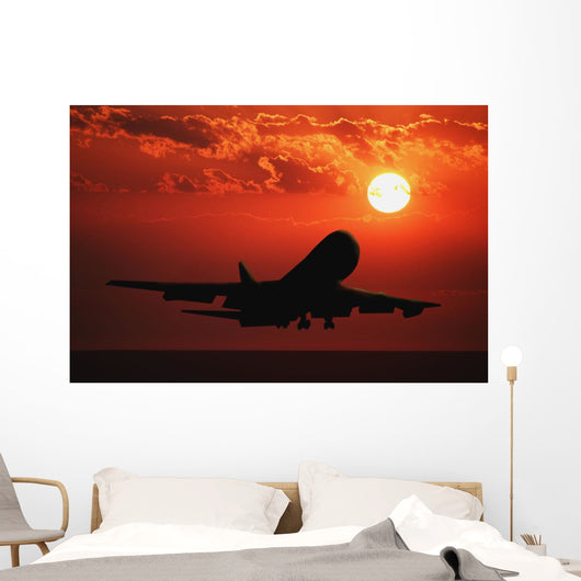 Airplane Landing At Sunset Wall Mural