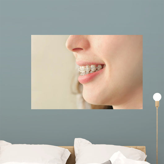 Girl smiles with braces Wall Mural