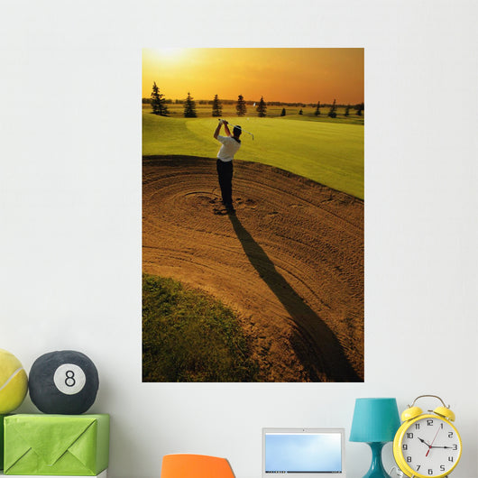 Golfer Taking A Swing From A Golf Bunker Wall Mural