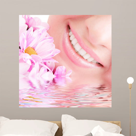 Smile of Young Woman With Flowers Wall Mural