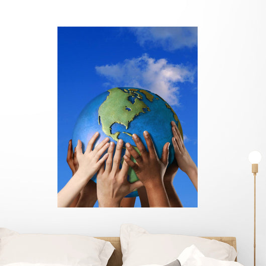 Hands On A Globe Wall Mural