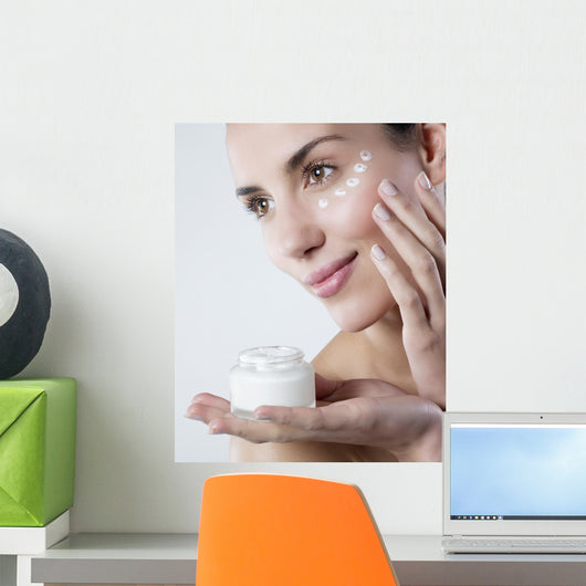 young woman smiling face care cream Wall Mural