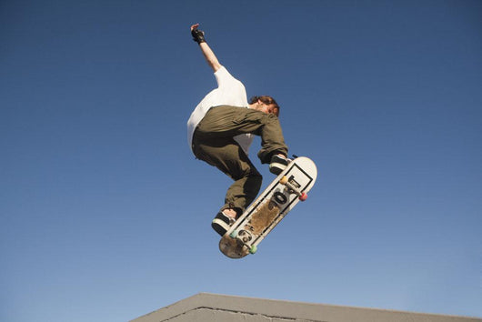 Low Angle View Of Young Male Skateboarder Wall Mural