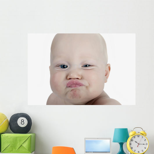 Baby Making A Funny Face Wall Mural