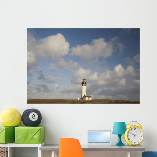 Lighthouse With Cloudy Backdrop Wall Mural