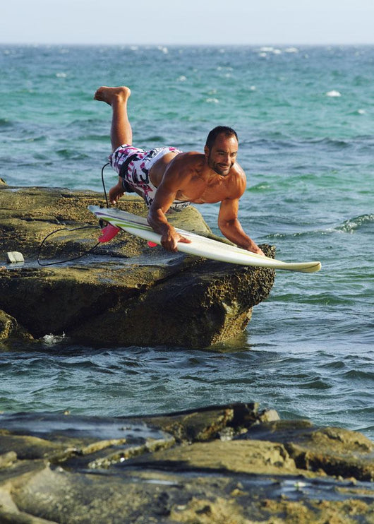 Man Jumping Into The Water On His Surf Board Wall Mural