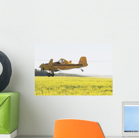 Crop Duster Spraying Flowering Canola Field Wall Mural
