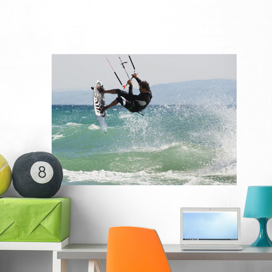 A Man Kitesurfing Off Dos Mares Beach In Front Of Hotel Dos Mares Wall Mural