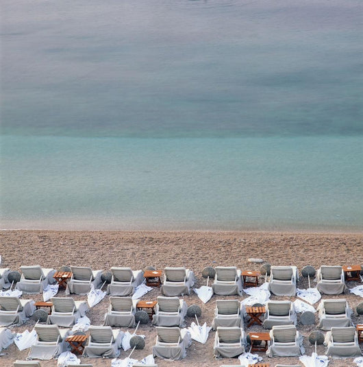 Deck Chairs On Empty Beach Wall Mural