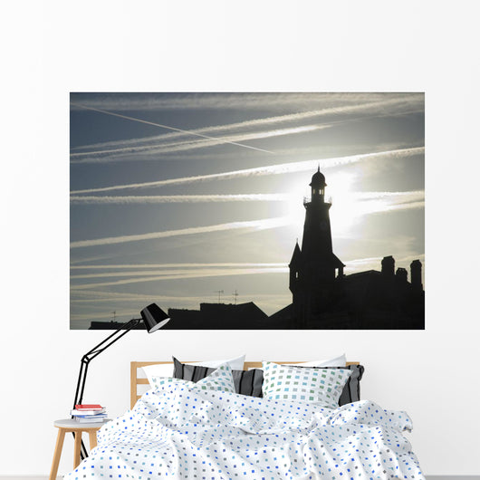 Airplane Contrails Above Lighthouse Wall Mural