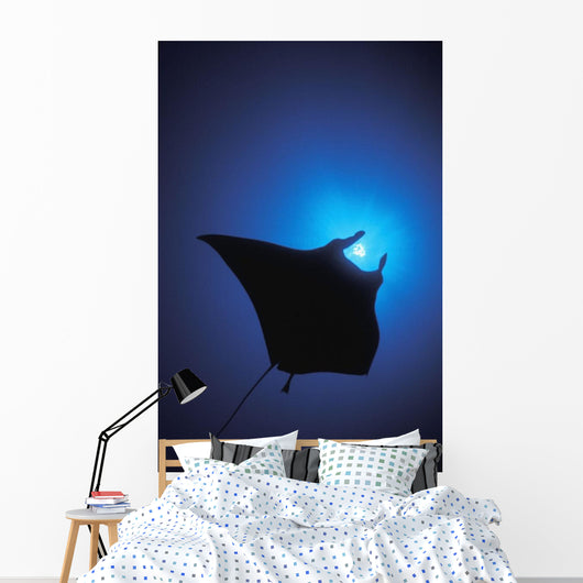 Silhouette Of Sting Ray And Shaft Of Light In Blue Water Wall Mural