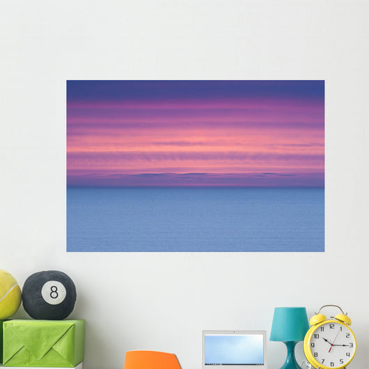 Dramatic Sky At Sunrise Over A Deserted Ocean Wall Mural