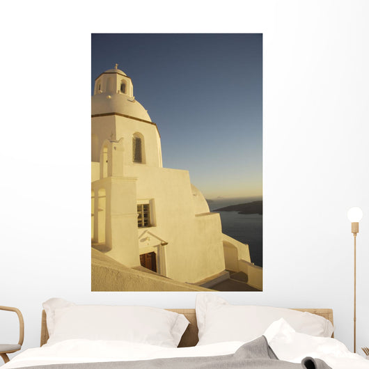 Whitewashed Building By Coastline Wall Mural