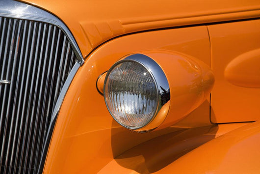 Orange Painted Vintage Car's Headlight And Front Grill Wall Mural