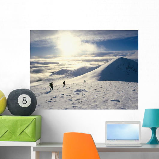 Hikers On A Mountaintop In The Snow Wall Mural