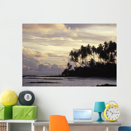 Silhouetted Palm Trees Over Beach At Sunset Wall Mural