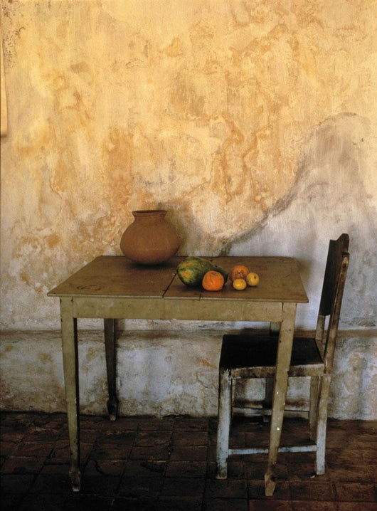 Table And Chairs Infront Of Weathered Wall Wall Mural