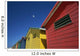 Seagull Flying Over Colorful Beach Huts Wall Mural