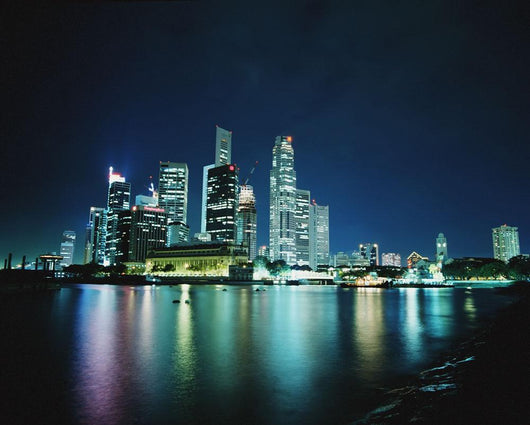 Business District Skyline At Night, With Reflections In Water Wall Mural
