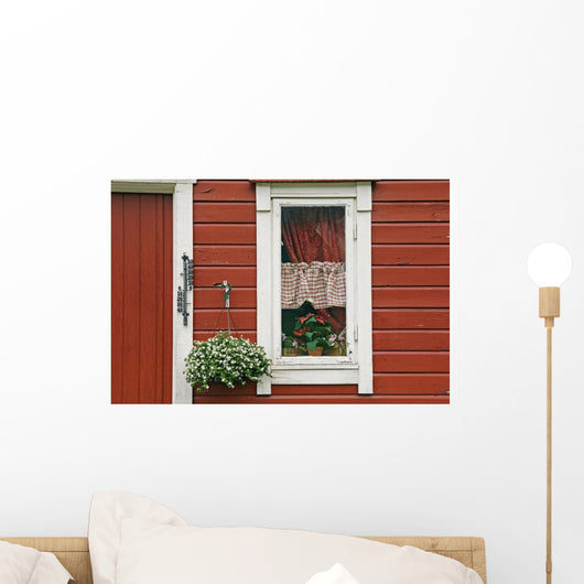 Red Wooden House With Plants In And By Window, Close Up Wall Mural