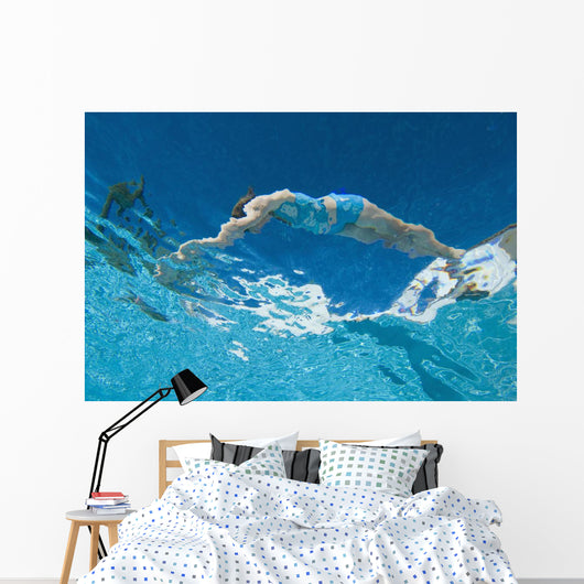Underwater View Of Woman Diving Into Pool Wall Mural