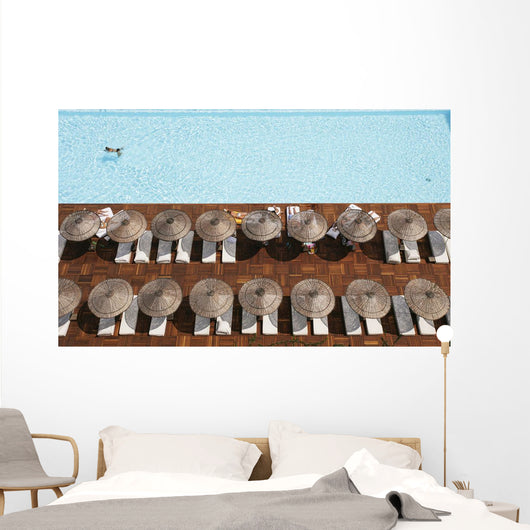 Man Swimming In Pool By Sunloungers, Aerial View Wall Mural