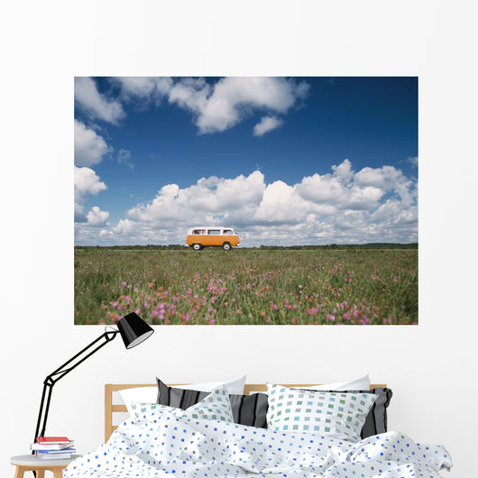 Campervan Going Down Road In Front Of Heather In Flower Wall Mural